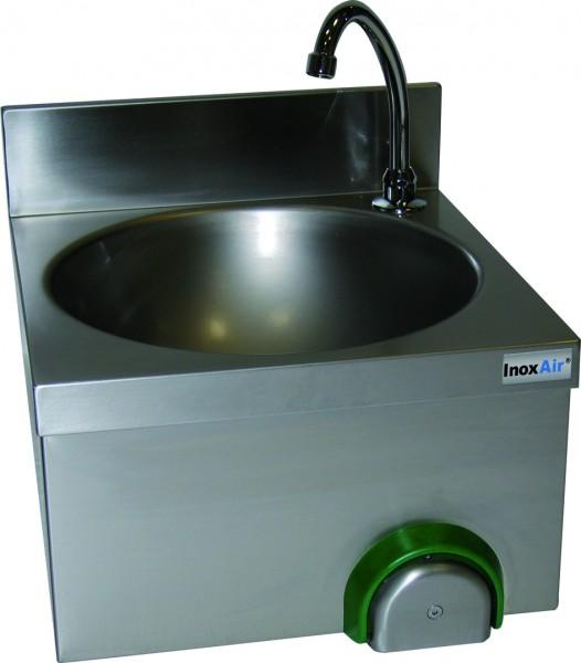 Handwaschbecken mit einem runden Becken und einer rückseitigen Aufkantung, mit Knie-oder Handbetätig
